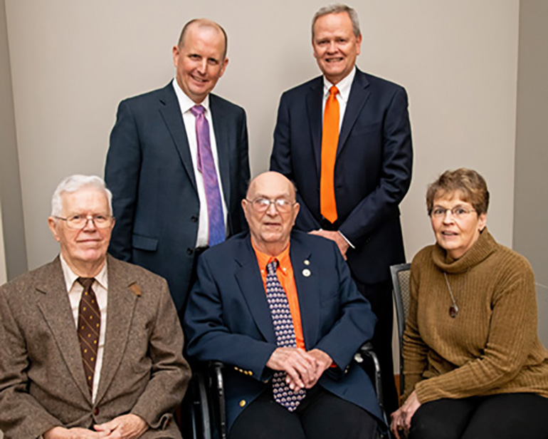 K.T. Wright, center, surrounded by (clockwise from left) LeRoy Biehl, Jim Lowe, Larry Firkins, and Betty Wright, K.T.'s wife, at the Dec. 5 event.