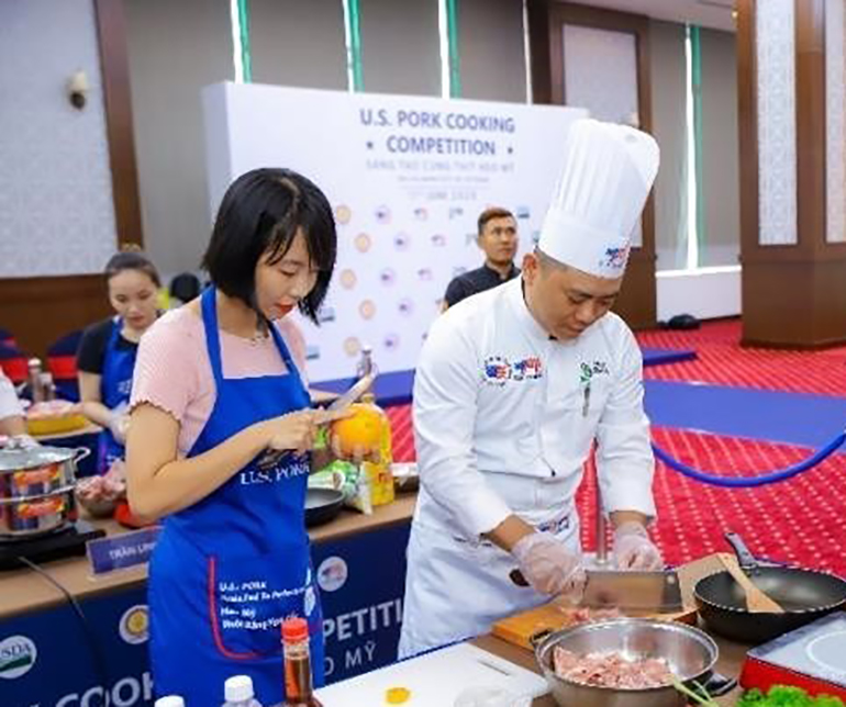 Chefs in Vietnam prepare dishes during a U.S. pork cooking competition.