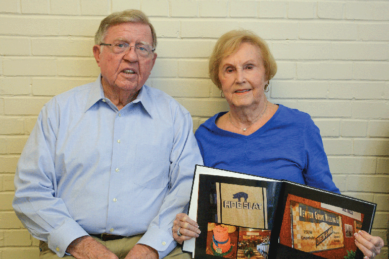 When Billy Herring (above, with wife Magdalene) and his brothers purchased Newton Grain and Feed, he assumed management responsibilities of the feed mill. Soon after, the family expanded the hog business with a 300-sow, farrow-to-finish farm.