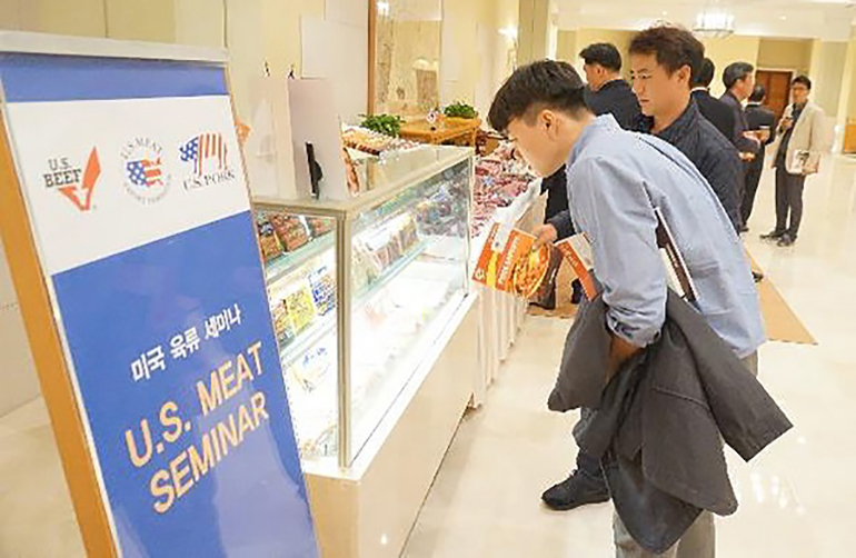 Prospective buyers learn about U.S. chilled pork and processed pork products at a USMEF seminar on South Korea's Jeju Island.
