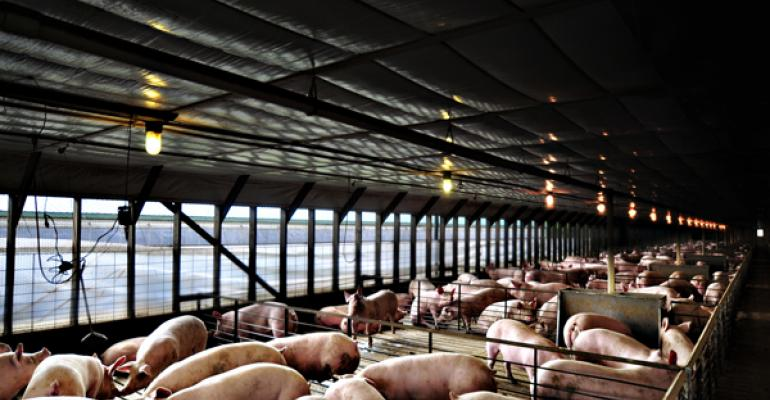 The familys 2000pig tunnelventilated barn was built in 1997 and a 2180pig barn was added to the operation in 2007