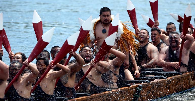 NGARUAWAHIA, NEW ZEALAND - NOVEMBER 08:  Five waka, maori canoes on the Waikato River salute Prince Charles, Prince of Wales and Camilla, Duchess of Cornwall at Turangawaewae Marae on November 8, 2015 in Ngaruawahia, New Zealand. The Royal couple are on a 12-day tour visiting seven regions in New Zealand and three states and one territory in Australia.
