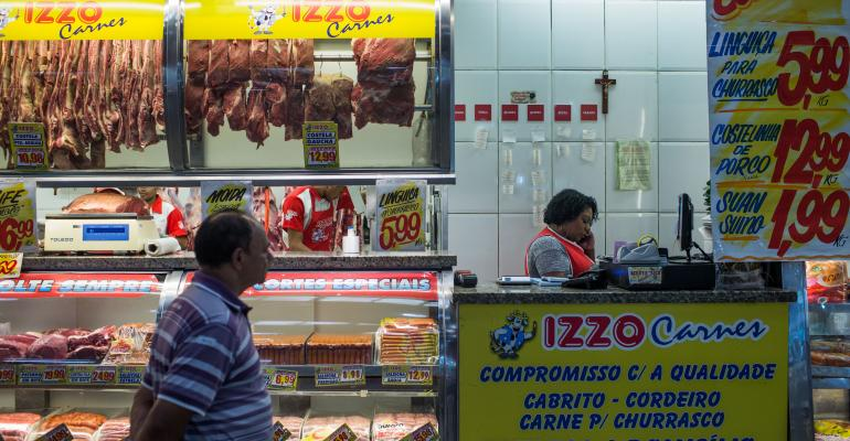 Customer browse at Brazilian meat counter