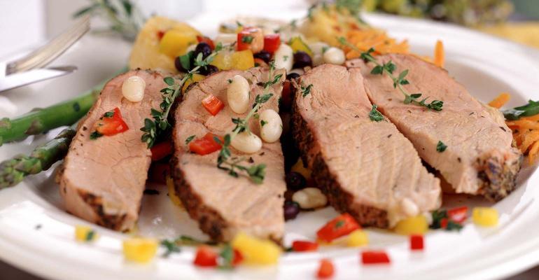 Pork meal on platter.