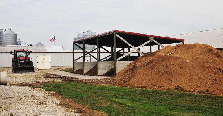 The Reed family uses an onsite covered composter for mortalities It features a concrete floor and three bays to help manage the composting process The composter greatly adds to our biosecurity and also saves money as compared to using a rendering service Ryan says A local sawmill provides the wood chips for the composter