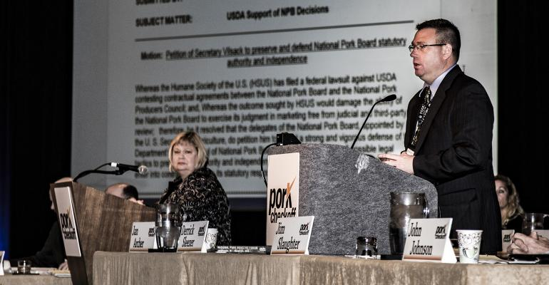 Derrick Sleezer from Cherokee, Iowa, and Jan Archer from Goldsboro, N.C., preside over a session of the 2016 Pork Forum Pork Checkoff delegates.