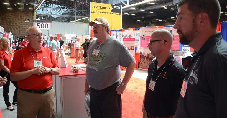 Michael Osborne, AAF Flanders vice president of global research & development (far left) explains the intricacies of the Sensor 360 filtration monitoring system to the New Product Tour judges Gary Anderson, Brad Leuwerke and Pat Thome.