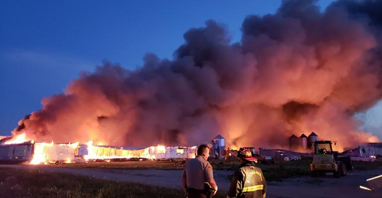 The fire consumed almost three acres of buildings on Borgic's southwestern Illinois 6,000 breed-to-wean operation.
