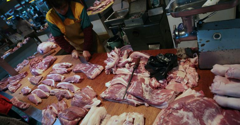 A vendor in China sell a variety of pork cuts
