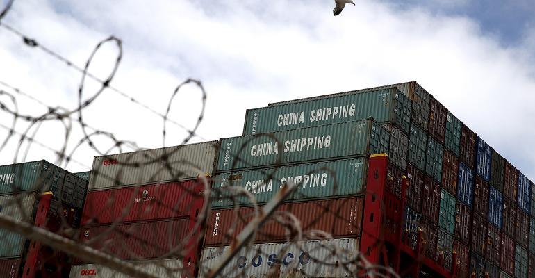 Shipping containers sit on the the Hong Kong-based CSCL East China Sea container ship at the Port of Oakland on June 20, 2018. in Oakland, Calif. U.S. president Donald Trump has threatened to impose 10 percent tariffs on $200 billion of Chinese imports if China retaliated against his previous tariffs on $50 billion of Chinese imports.