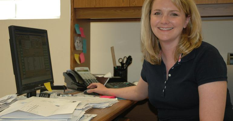 Chris Chinn at a desk in her farm office.