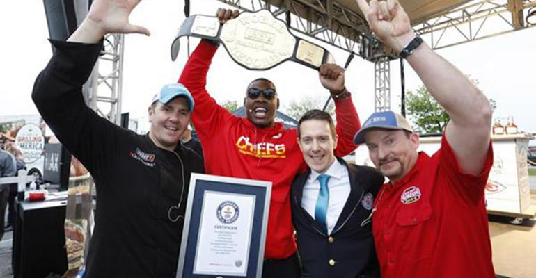 From left to right: Weber Grillmaster Kevin Kolman, Kansas City Chiefs' Defensive End Chris Jones, Guinness World Records Adjudicator Philip Robertson, and World Champion Pitmaster Chris Lilly celebrate as Smithfield set the Guinness World Records title for the largest grilling lesson on April 27.