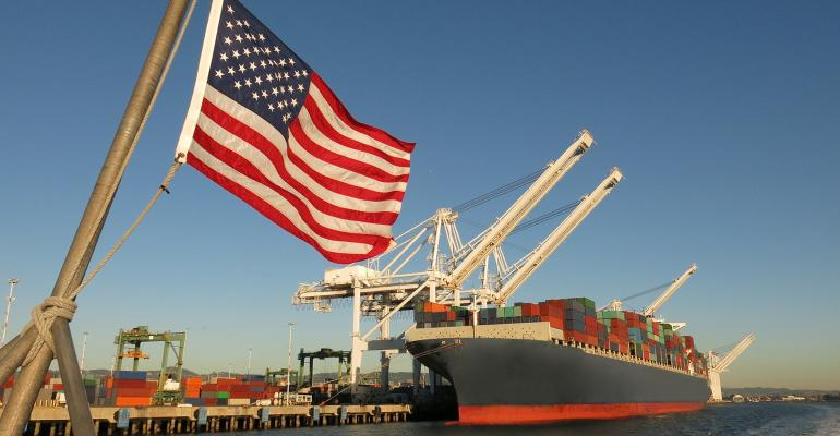 U.S. flag flying ahead of a ship loaded for export