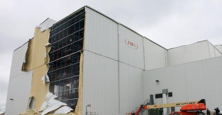 The distribution center of the JBS USA pork processing plant in Marshalltown, Iowa, was heavily damaged by an EF-3 tornado July 19.