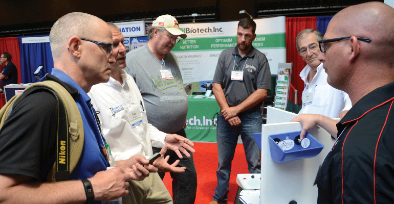 Dan Wagner (second from left) with Fasten Solutions explains the versatility and adaptability of the Krate Klip to the New Product Tour judges panel of Gary Anderson, Pat Thome and Brad Leuwerke. Jerry Karp (second from right) with Fasten Solutions and National Hog Farmer's Kevin Schulz (far left) listen in.
