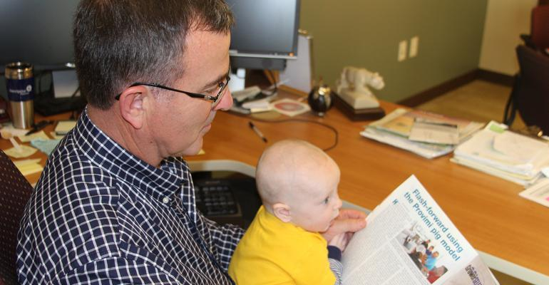 If the youth are the future of the U.S. swine industry, it is never too early to get them interested. Lee Johnston, professor of Swine Nutrition and Management at the University of Minnesota West Central Research and Outreach Center in Morris, and grandson Tysen Lee Johnston peruse the National Hog Farmer magazine.