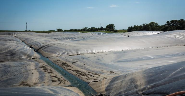 Impermeable cover on a manure storage that allows collection of biogas, keeps rainwater out of the manure and helps minimize odor and ammonia loss, but is it cost feasible?