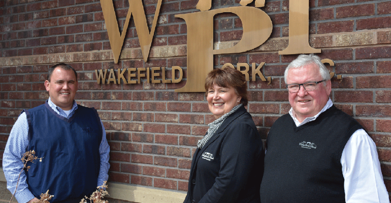 Lincoln (left), Mary and Steve Langhorst, the owners of Wakefield Pork Inc., know the strength of the company is in the value of its employees and contract growers.