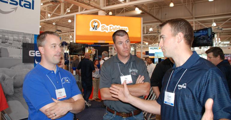 Gestal's Hyatt Frobose, right, explains to panel members (left to right) Aaron Lower and Pat Thome, the cost savings producers may realize by using the Gestal Quattro lactating sow feeding system.