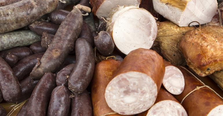Different smoked sausages on a bazaar in Poland