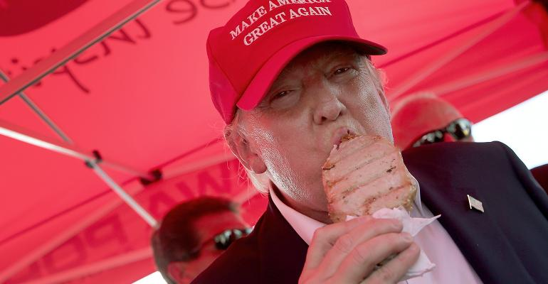Donald Trump eating pork chop on a stick at Iowa State Fair