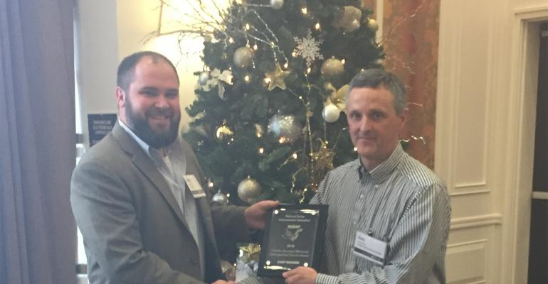 Justin Fix, president National Swine Improvement Federation (left) presents the award to Gary Rohrer, acting research leader at the U.S. Meat Animal Research Center.