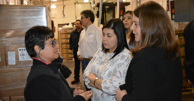 Alejandra Valdez (left), USMEF technical services manager for Mexico, Central America and the Dominican Republic, discusses labeling requirements with USMEF members at a cold storage facility near Laredo, Texas.