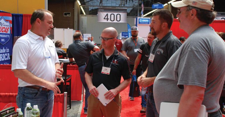Eric Holdmeyer, Midwest Ag Solutions sales, pitches the benefits of Xtreme BioShield to the New Product Tour judges Brad Leuwerke, Pat Thome and Gary Anderson.
