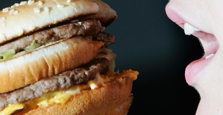 A woman eating a hamburger