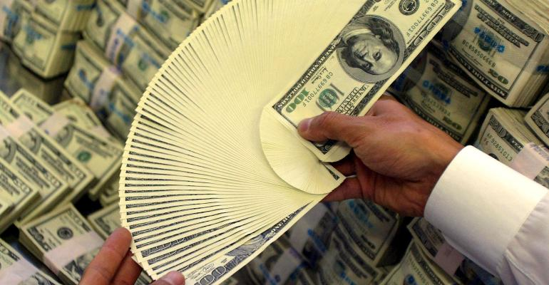 A handful of $100 bills, fanned out