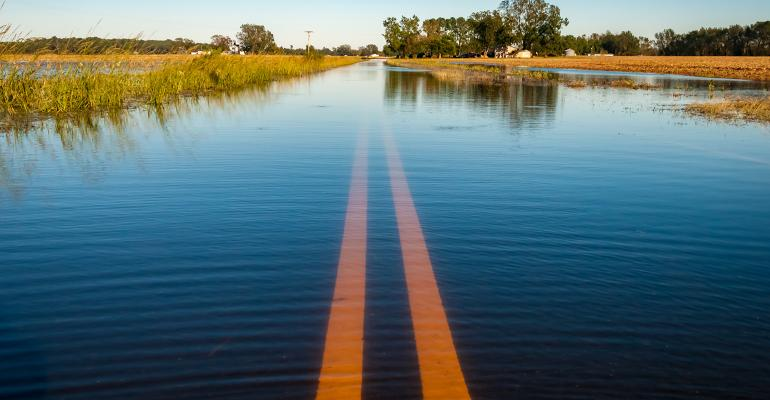 hurricane-flooded road and fields