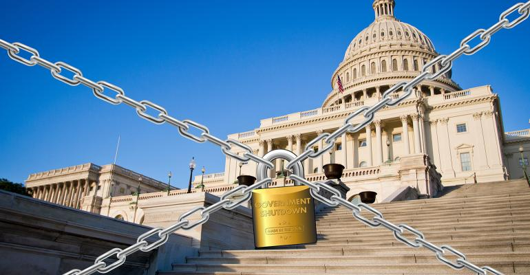 U.S. capitol building with chains and padlock during government shutdown