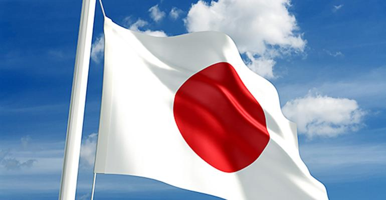 Japanese flag flying against a blue sky