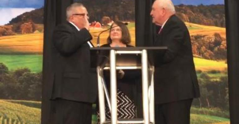 U.S. Secretary of Agriculture Sonny Perdue administers the oath of office to Under Secretary for Farm and Foreign Agricultural Service Bill Northey.