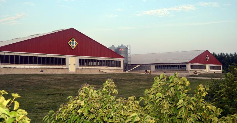 Red hog barns side-by-side