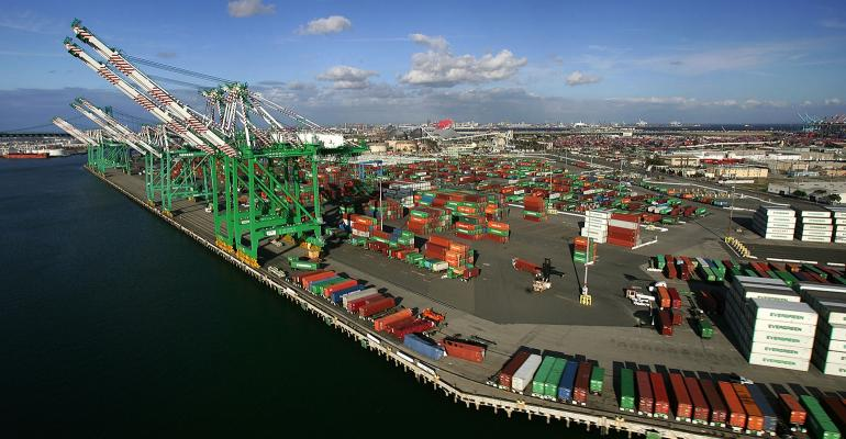 Shipping containers crowd docks near cranes at the ports of Los Angeles and Long Beach in California.