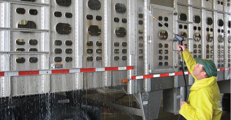 Power washing a livestock trailer
