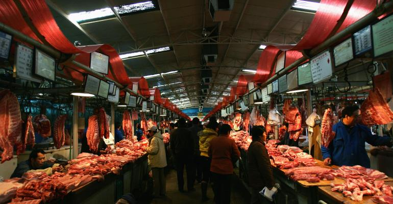 Consumers buy the pork in Beijing, China.