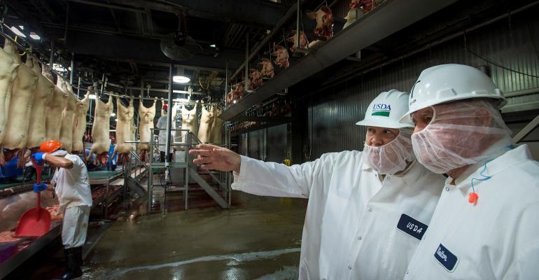 Secretary Perdue touring pork slaughterhouse facility