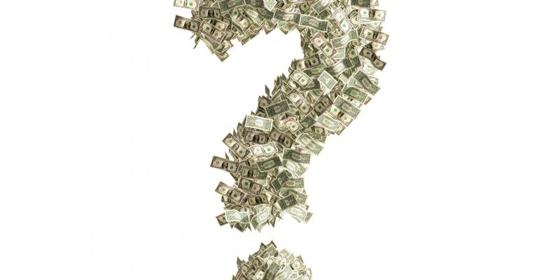 """Question mark """"?"""" made from Dollar bills, isolated on white background."""