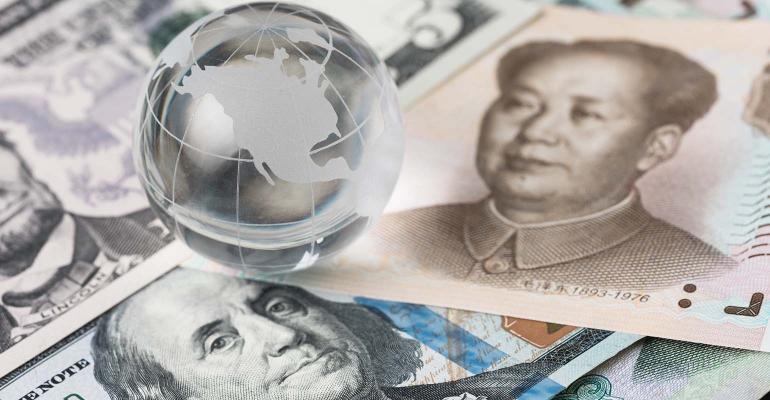 decoraton glass globe on US dollar and china yuan banknotes.