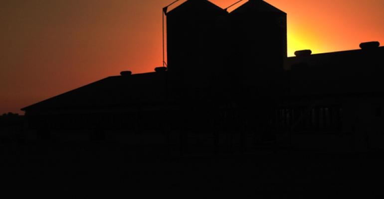A finishing barn is silhouetted at dusk on Dahl Family Farms near Dawson MN Wayne and Laura Dahl have been named 2012 Pork Industry Environmental Stewards for the excellent job they are doing of protecting the environment as they strive to build a legacy for their grandchildren