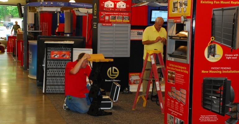 Assembling equipment at World Pork Expo