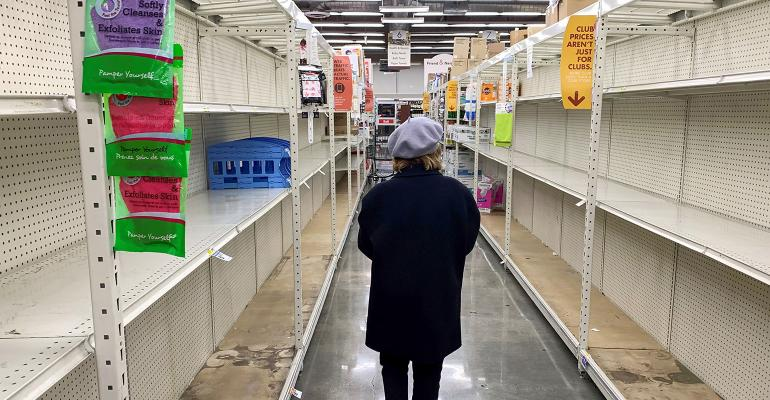 Empty shelves in a grocery store due to panic caused by coronavirus