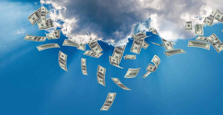 Money falling from the silver lining of clouds