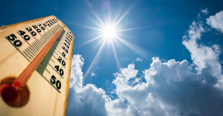 Hot summer sun beating down on a thermometer