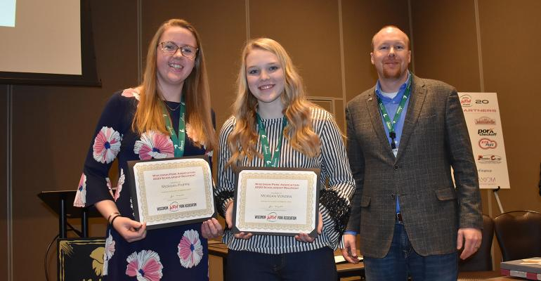 Wisconsin Pork Association President, Jim Magolski, right, presents WPA Scholarship to Morgan Vondra, middle, and Morgan Phipps, left.