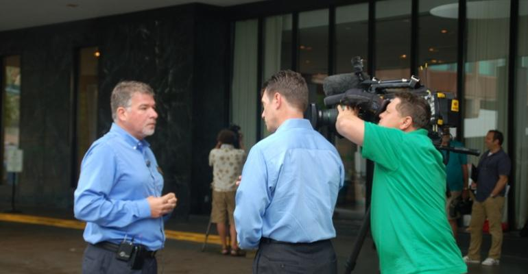 Dave Preisler left Executive Director of the Minnesota Pork Producers Association answers reporter questions following a Mercy for Animals press conference in Minneapolis