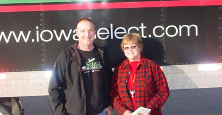 Iowa Select Farms Finishing Supervisor Tom Boge and Aplington Parkersburg Food Pantry Coordinator Margaret Schuck stand in front of the truck delivering the pork loin roasts to local pantries Photo courtesy of Parkersburg Eclipse News Review