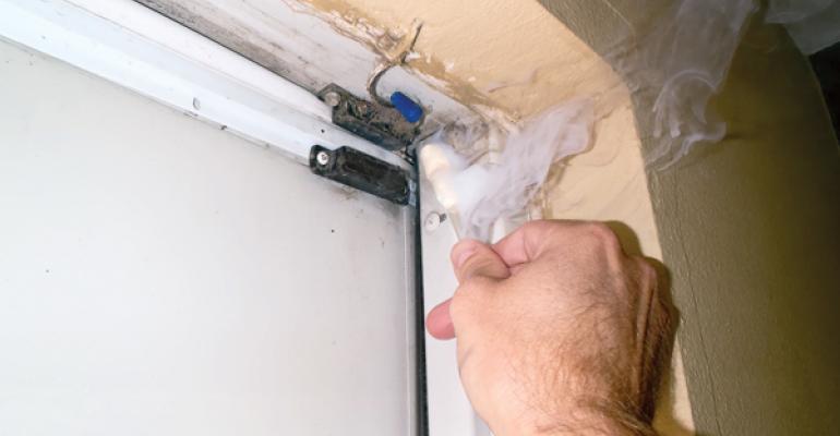 Smoke sticks help detect air leakage around doors